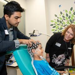 Dr Kartik Lyer (L) and Associate Professor Karen Barlow (R) in the KidStim Lab